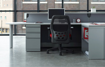 A white desk and black chair in an office environment.
